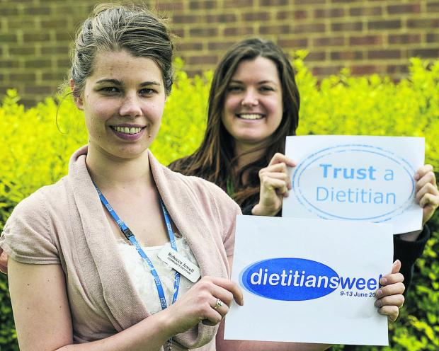 This Is Wiltshire: Rebecca Jewell, left, and Lindsey Ratledge, a Macmillan oncology dietitian, raising awareness of the week's events