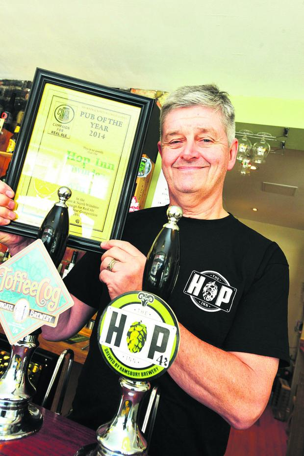 This Is Wiltshire: Jason Putt with his CAMRA certificate. Picture: THOMAS KELSEY
