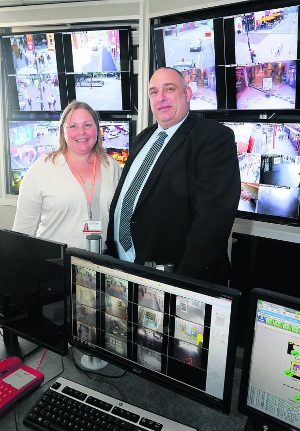This Is Wiltshire: Cabinet member for public safety Councillor Emma Faramarzi with  security manager for Swindon council Mark Stratford in the CCTV control room