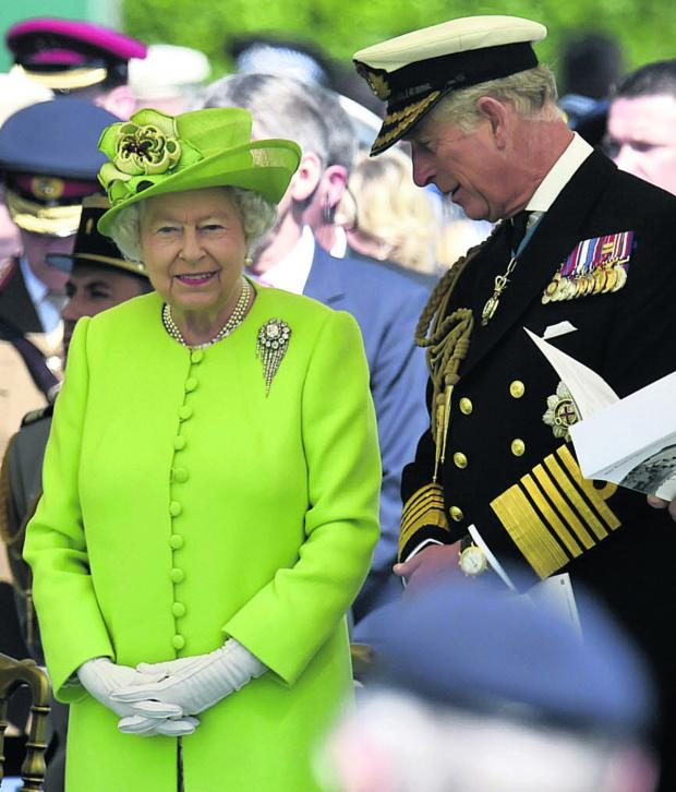 This Is Wiltshire: The Queen and the Prince of Wales attend the service of remembrance at the Commonwealth War Graves Commission Cemetery, Bayeux, to mark 70th anniversary of the D-Day landings