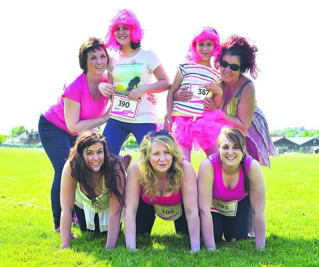 This Is Wiltshire: The Ducks Divas take a bow after finishing the Race