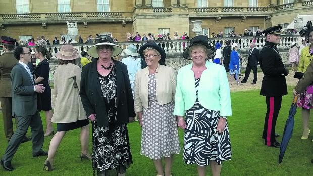 This Is Wiltshire: Cossor's Shop volunteers Di Stephens, Jackie Giddings and Brenda Andrews take in the sights and sounds at the palace