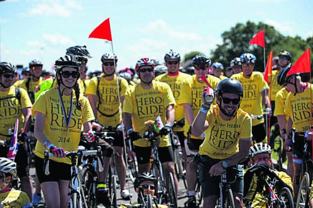 This Is Wiltshire: Mark Cavendish and wife Peta join the other Hero Ride fundraisers. Steve Parsons/PA Wire