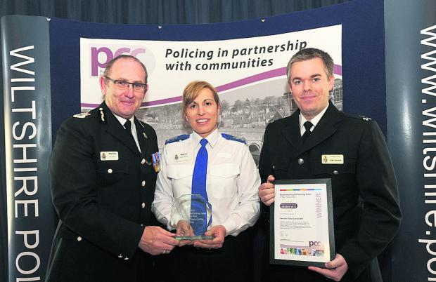 This Is Wiltshire: Members of the Swindon Town Centre, Broadgreen NPT, team receive their award from Chief Constable Pat Geenty