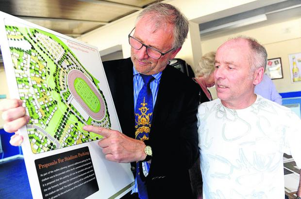 This Is Wiltshire: Clarke Osborne, left, and Roger Wheeler look over plans for the Abbey Stadium site at last year's consultation
