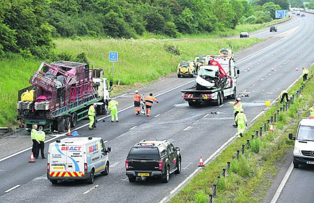 This Is Wiltshire: The accident scene on the M4 on Monday. Three people have now died