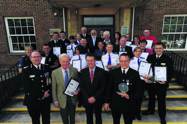 This Is Wiltshire: Wiltshire Chief Constable Pat Geenty and Kieran Kilgallen, of the office of the PCC, with the winners, front: Nigel Beaven, PC Pete Jung and PCSO Juliet Evans PCSO, and, back: PCSO Emma Millarvie and PC Luke Atkinson