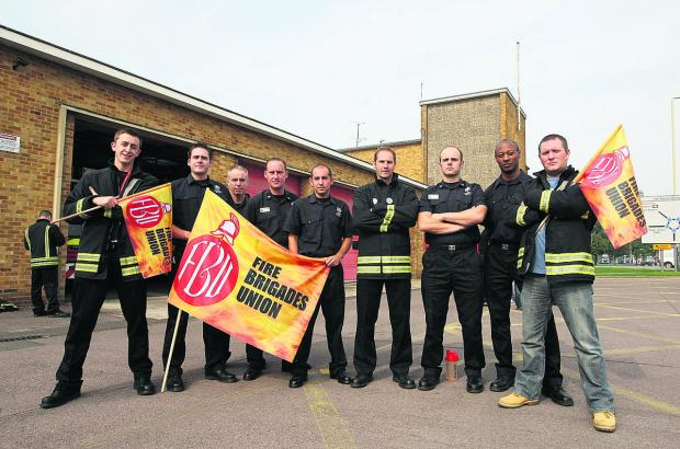 This Is Wiltshire: Firefighters pictured outside Drove fire station on a previous strike against proposed changes to their pensions