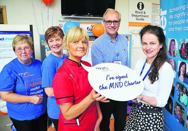 This Is Wiltshire: Doctors and nurses will sign a motor neurone disease charter setting out what they aim to do for patients at GWH. Left to right are  Barbara Crook, Alison Aviss, Julie Marsham, Graham Lennox and  Elizabeth Price