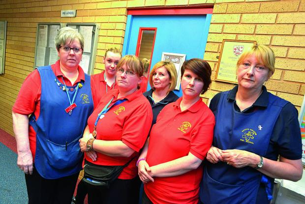 This Is Wiltshire: Haydon Meadow pre school staff at the sessional door which has caused issues for the education watchdog. Picture: THOMAS KELSEY