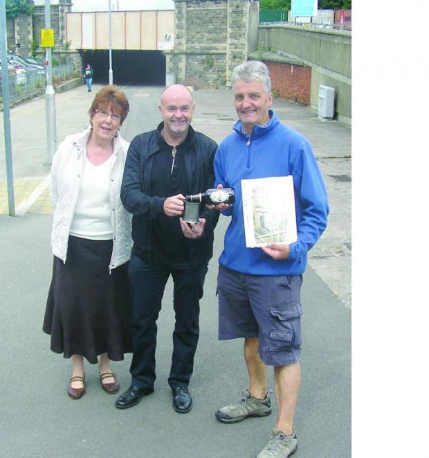 This Is Wiltshire: Barry Leighton presents Diane Everett and Andy Binks, of the Swindon Society, with Richard Bullen's mug at the location of the Union Hotel, now part of a car park adjoining Swindon station