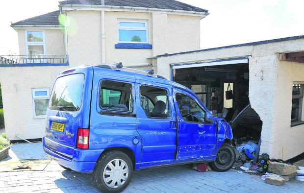 This Is Wiltshire: The car which smashed into Judy and Basil Jones' garage in Grosvenor Road