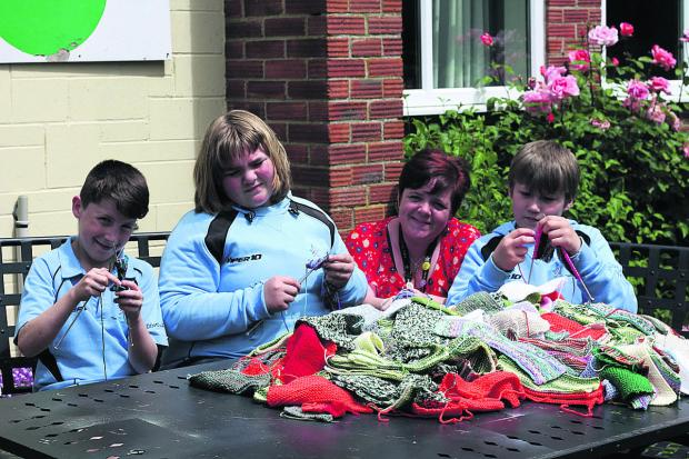 This Is Wiltshire: Support worker Alyson Pearson with pupils Eddie-Jay, Charlotte and Dylan hard at work