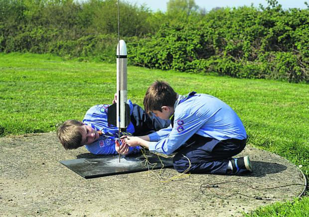 This Is Wiltshire: Jean-Benoit, left, and Joe of 10th Chippenham Air Scouts prepare their rocket for firing