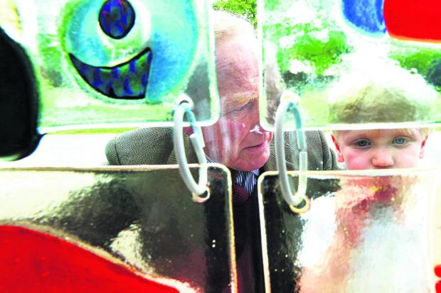 This Is Wiltshire: Hugo Fallon shows his grandfather George Streatfeild the glass artwork created at Prior Park Prep School