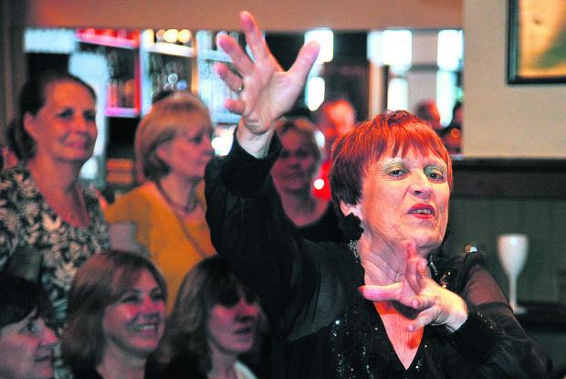 This Is Wiltshire: Sheila Harrod conducts Kentwood show choir which performed at Baker Street pub