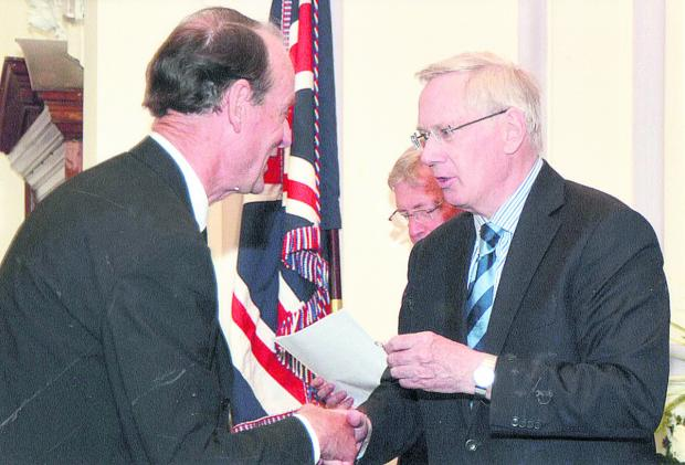 This Is Wiltshire: Des Williams, left, and inset, recieving his BEM from the Duke of Gloucester