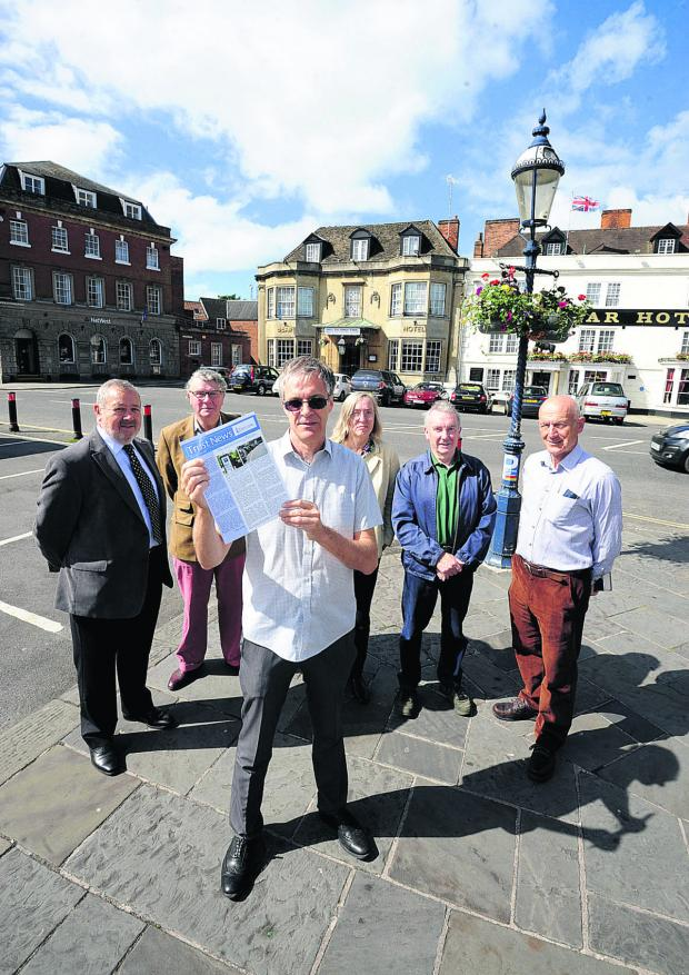 This Is Wiltshire: Trust For Devizes members John Baumber, left, Peter Allfrey, David Dawson, Philippa Morgan, John Girvan and James Flood with the survey into free parking