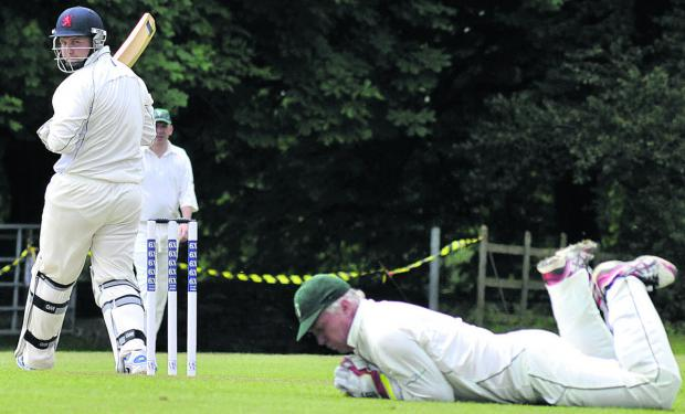 This Is Wiltshire: Winsley wicketkeeper Kevin Hendy dives to stop Haydn Amor's edged shot for Burbage