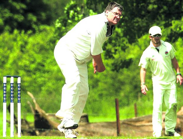 This Is Wiltshire: Urchfont bowler Keith Bills pictured during his side's victory over Bradford on Avon, in which he took four wickets
