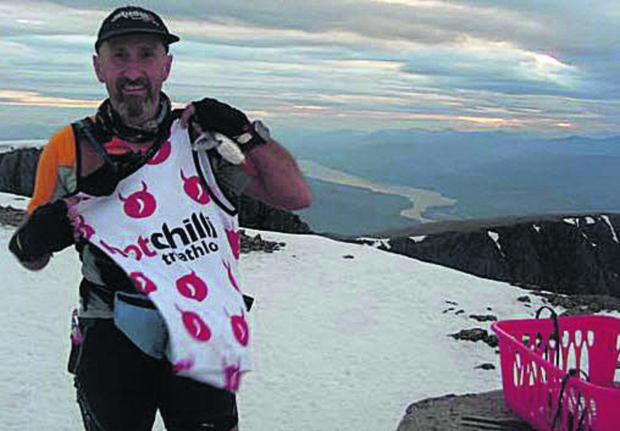 This Is Wiltshire: Tom Stokes, pictured on Ben Nevis during the City to Summit Triathlon