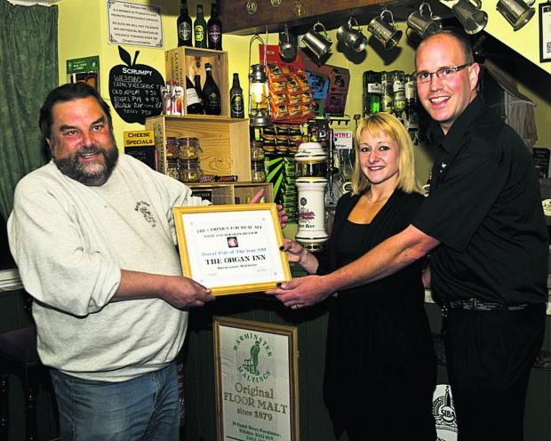 This Is Wiltshire: Dennis Rahilly of CAMRA with Daniel and Carly Keene of The Organ Inn, Warminster