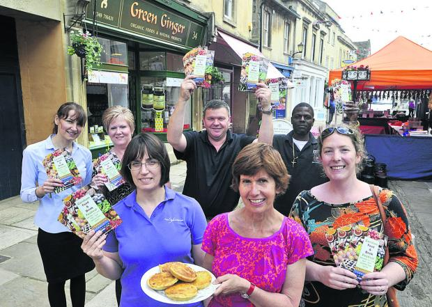 This Is Wiltshire: Clare Walsh with her Corsham Tarts and traders, from left, Christine Clancy, Yvette Hartley, Michael Thomas and Clarence Charlton and organiser Eleanor Trueman, right, promote the food festival