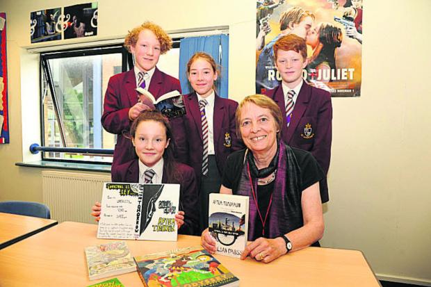 This Is Wiltshire: Gillian Cross with cover design winner Ella, seated, and fellow pupils Archie, Annabel and Kyle