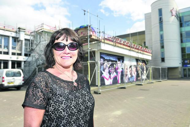 This Is Wiltshire: Swindon College work skills tutor Sharon Lloyd outside the Lyra building which is being refurbished