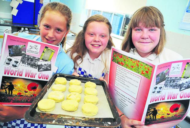 This Is Wiltshire: May, Izzy and Emily prepare to bake their biscuits