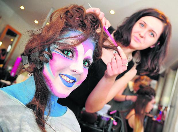 This Is Wiltshire: Aisha Cubbage gives Katrina Cook a hairstyle to match her psychedelic make-up for the 160 Appeal at the Hair Group salon