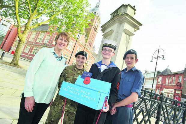 This Is Wiltshire: Shirley Ludford, left, the manager of Swindon 105.5 Radio, launching this year's poppy appeal with Veronica Bretti, Elizabeth Lawton and Lewis Williams