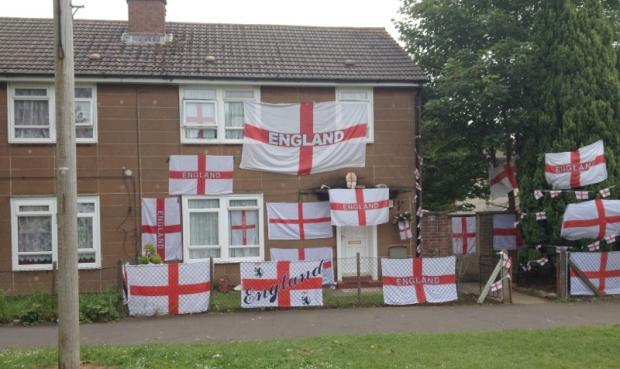 This Is Wiltshire: Graham Dunn's Penhill Drive home is adorned with England flags