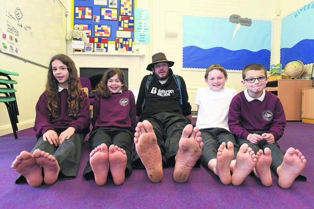 This Is Wiltshire: Pupils at Rushall School meet poet and fundraiser Philip Wells during his 1,000-mile barefoot trek                (DV1353) By Diane Vose