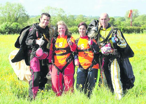 This Is Wiltshire: Theresa Carpenter with her daughter Jenna and instructors Dylan, left, and Matt, right, after her skydive for the MS Society. Inset, Theresa makes the jump