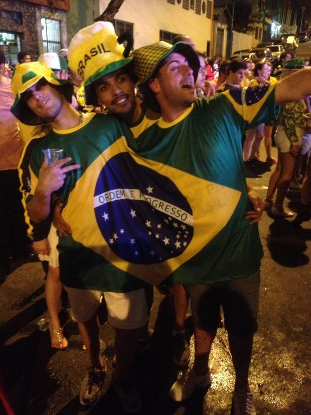 This Is Wiltshire: Justin Cook, right, enjoying the party in Sao Paolo last night