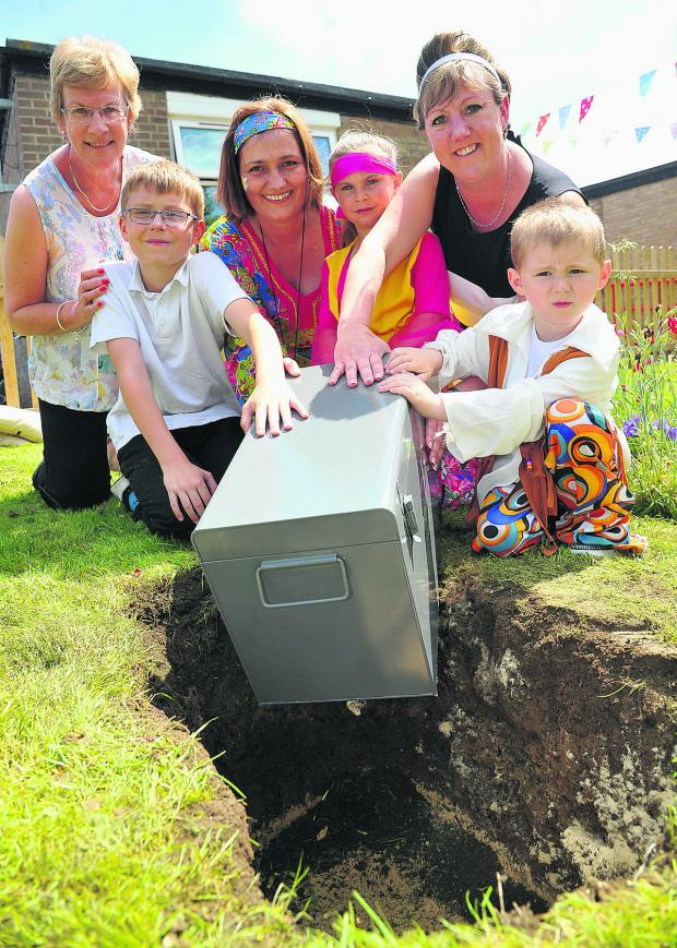 This Is Wiltshire: A time capsule is safely tucked into the ground at Oaktree Nursery and Primary School's celebration of 50 years at its site. Left to right are Erica Milsom, Rys, Julie Dyer, Tiffany, headteacher Sue Rees and Harvey