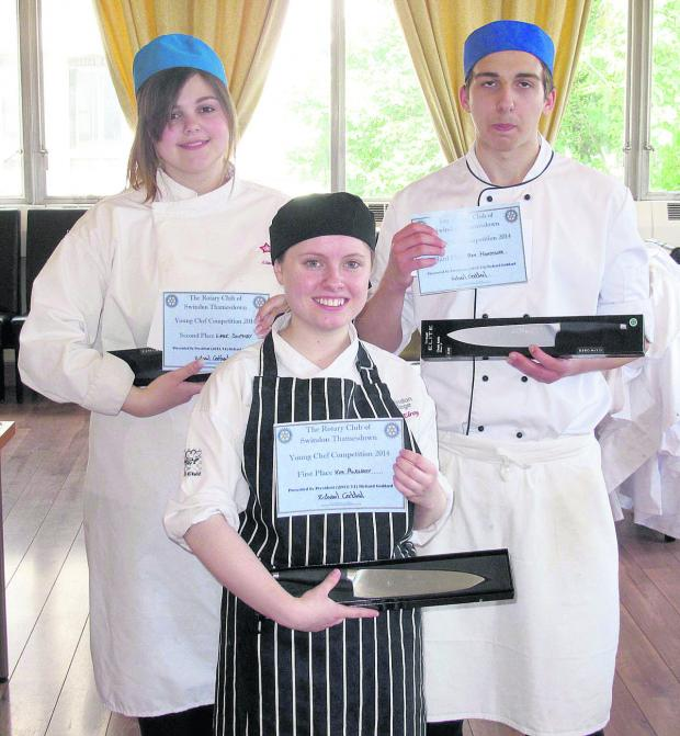 This Is Wiltshire: Kim McElroy, centre, the winner of the Rotary Club of Thamesdown's annual Young Chef Competition for catering students at Swindon's North Star College.  She is pictured with second place winner Lianne Southby and third place winner Ben Heathcote