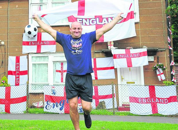 This Is Wiltshire: England fan Graham Dunn is carrying on a tradition he has kept up for the best part of 30 years, by covering his home in St George's flags in support of the Three Lions