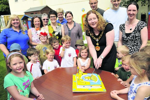 This Is Wiltshire: Royal Wootton Bassett mayor Sue Hughes cuts the cake to celebrate Old Court Pre-school's 40th anniversary. Picture: DAVID MORRISON