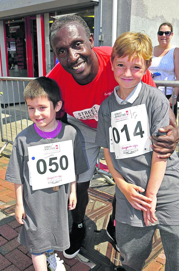 This Is Wiltshire: Rhys Frayling, six, Linford Christie and Mackenzie Alexander, 10