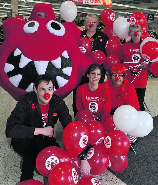 This Is Wiltshire: Staff at Sainsbury's in Trowbridge take part in Red Nose Day last year. Funding from Comic Relief will help hundreds of isolated older people in Wiltshire