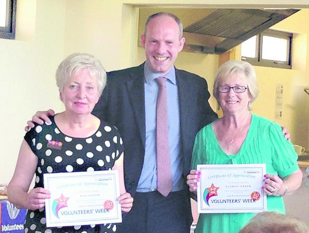 This Is Wiltshire: Pam Baker and Glenise Gough are presented with their certificates by Swindon North MP Justin Tomlinson