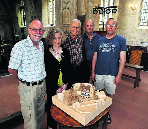 This Is Wiltshire: Tony Scorer, Ida McConnell, Charlie Slater, Stephen Brazier and Paul Morgan look at the model for the cloister they want built at St Mary's Church in Devizes