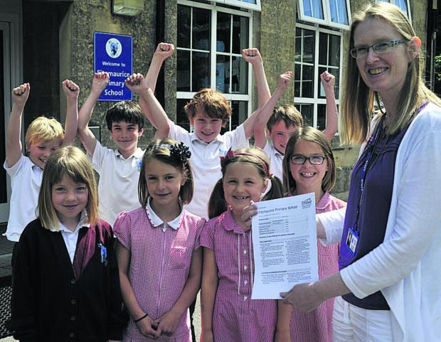This Is Wiltshire: Headteacher Tracey Dunn and pupils  celebrate the results of Fitzmaurice Primary School's Ofsted report