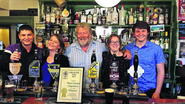 This Is Wiltshire: From left are bar staff Stuart Taverner, Emma Dixon, landlord Steve Jenner, Wendy Somerville-Woodiwis and Dan Charlton