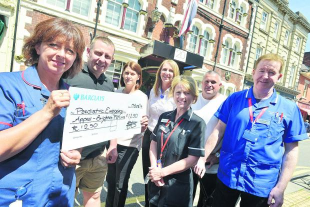 This Is Wiltshire: At the cheque presentation are Ella Hutchinson, Darren Turner, Vicky Turner, Jennifer Green, Annette Baskerville, Darren Westlake and Tony McCluskey