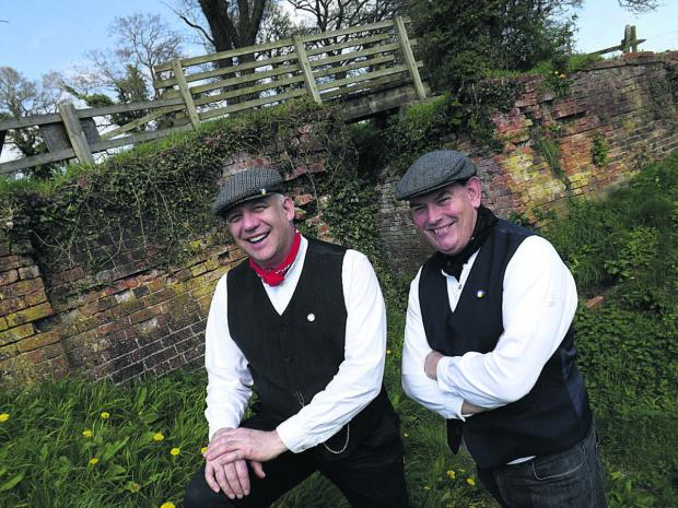 This Is Wiltshire: Canal Trust volunteers Derek Flexer, left, and Alan Lank prepare to welcome visitors