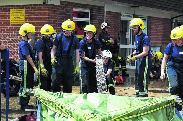 This Is Wiltshire: The first day of the Salamander training course at Devizes Fire Station. Participants are busy constructing a water dam