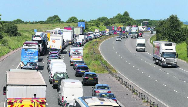 This Is Wiltshire: Traffic queueing on the M4 after an accident closed the motorway